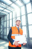 Attractive young builder is working on his project Royalty Free Stock Photo