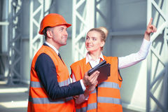 Attractive young builders are discussing the new Stock Photography