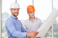 Attractive young builders are working on a new Royalty Free Stock Photo