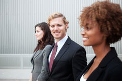 Attractive young business group standing together at office Stock Photos