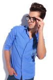 Attractive young business man fixing his glasess. Stock Photo