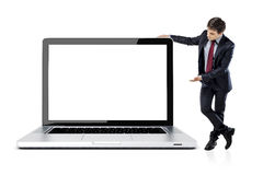 Attractive young business man with laptop Royalty Free Stock Photography
