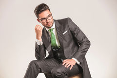 Attractive young business man looking down Stock Photo