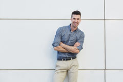 Attractive young business man standing with arms crossed Stock Photo