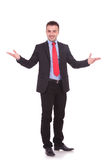 Attractive young business man welcoming you Stock Image