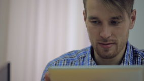 Attractive young business partner working in his stock footage