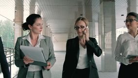Attractive young business team walking through an arch and doing their business stock footage