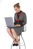 Attractive young business woman. Sitting on bar chair and working on laptop royalty free stock images