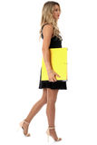 Attractive Young Business Woman Carrying a Yellow Box File Stock Image