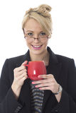 Attractive Young Business Woman Drinking a Mug of Tea Royalty Free Stock Photography