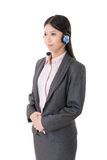 Attractive young business woman with a headphone Stock Image