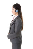 Attractive young business woman with a headphone Royalty Free Stock Image