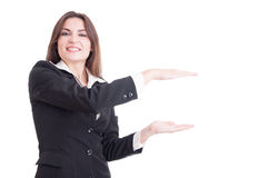 Attractive and young business woman presenting white copy space Royalty Free Stock Photography