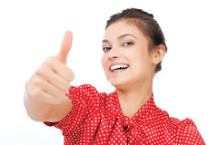 Attractive young business woman with thumb up. Isolated on stock photography