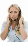 Attractive Young Business Woman Using a Telephone Headset Royalty Free Stock Photos