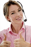Attractive Young Business Woman Using a Telephone Headset Royalty Free Stock Photo