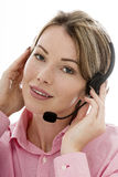Attractive Young Business Woman Using a Telephone Headset Stock Images