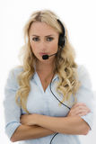 Attractive Young Business Woman Using a Telephone Headset Stock Image