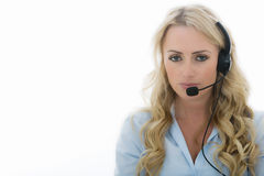 Attractive Young Business Woman Using a Telephone Headset. Attractive Thoughtful Young Professional Business Woman, With Blonde Long Hair, Using a Telephone Royalty Free Stock Images