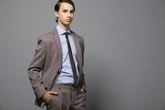 Attractive young businessman. Attractive young businessman in gray suit Stock Image