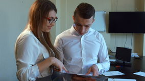 An attractive young businessman and businesswoman stock footage