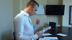 An attractive young businessman and businesswoman stock video