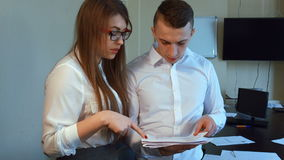 An attractive young businessman and businesswoman stock video footage