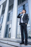Attractive young businessman is communicating on Stock Photos