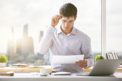 Attractive young businessman doing paperwork Stock Images