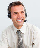 Attractive young businessman with a headset on Stock Photography
