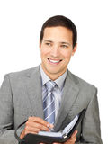 Attractive young businessman holding an agenda Royalty Free Stock Photos