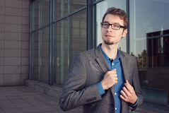 Attractive young businessman looking satisfied Stock Photography
