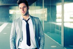 Attractive young businessman in office building Royalty Free Stock Photos