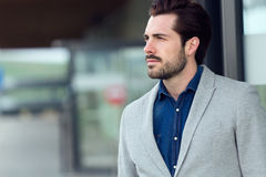 Attractive young businessman outside in airport Royalty Free Stock Image