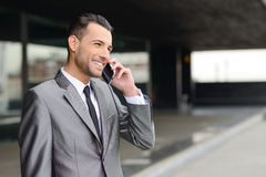 Attractive young businessman on the phone in an office building Royalty Free Stock Image
