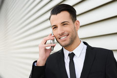 Attractive young businessman on the phone in an office building Royalty Free Stock Photography