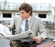 Business man reading paper. Royalty Free Stock Photo