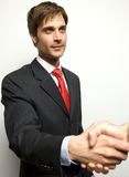 Attractive Young Businessman shaking hands Royalty Free Stock Photography