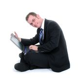 Attractive Young Businessman Sitting On Floor With Laptop Royalty Free Stock Photo