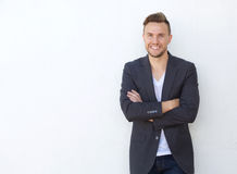 Attractive young businessman smiling against white wall Royalty Free Stock Images
