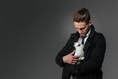 Attractive young businessman standing and holding rabbit Stock Photography