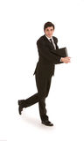 Businessman walking with a folder Royalty Free Stock Image