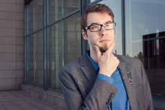 Attractive young businessman thinking Stock Image