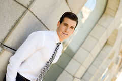 Attractive young businessman in urban background Stock Photos