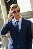 Attractive young businessman in urban background Royalty Free Stock Images
