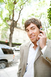 Businessman with ear set. Stock Photos