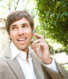 Businessman with ear set. Royalty Free Stock Image