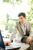 Businessman with laptop. Stock Image