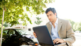 Businessman with laptop. royalty free stock image