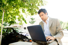 Businessman with laptop. Stock Images